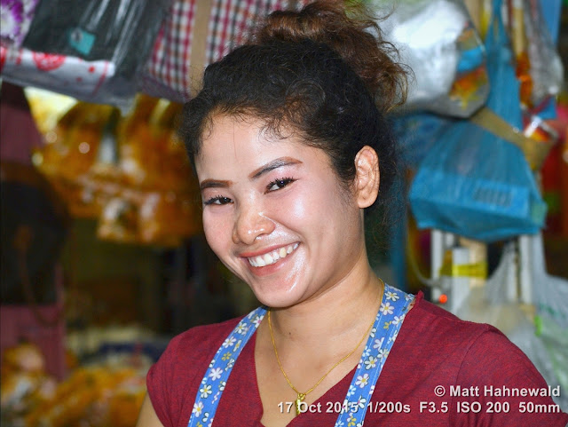 Facing the World, © Matt Hahnewald, people, closeup, street portrait, Thailand, Bangkok, flower market, flowers, saleslady, flash, 50 mm prime lens, florist