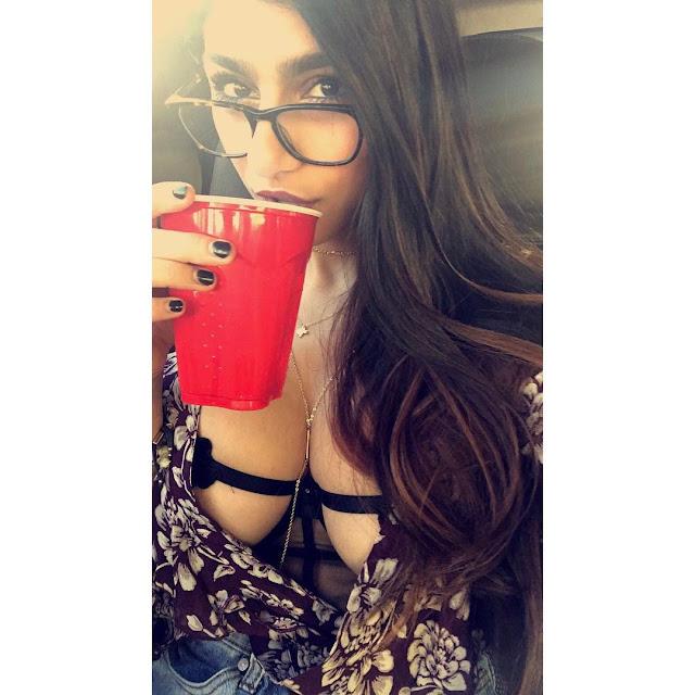 Mia-Khalifa-drink-Chocolate-milk-roadie-and-shows-her-boobs