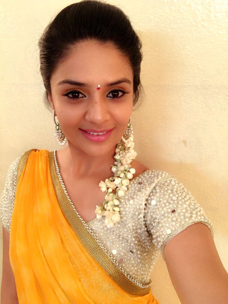 Tv Anchor Sreemukhi Long Hair In Yellow Half Saree