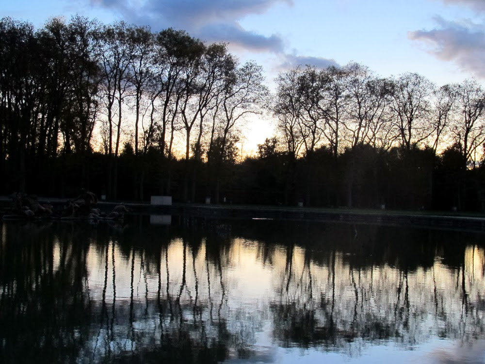 Dusk in the beautiful Versailles Palace gardens in France