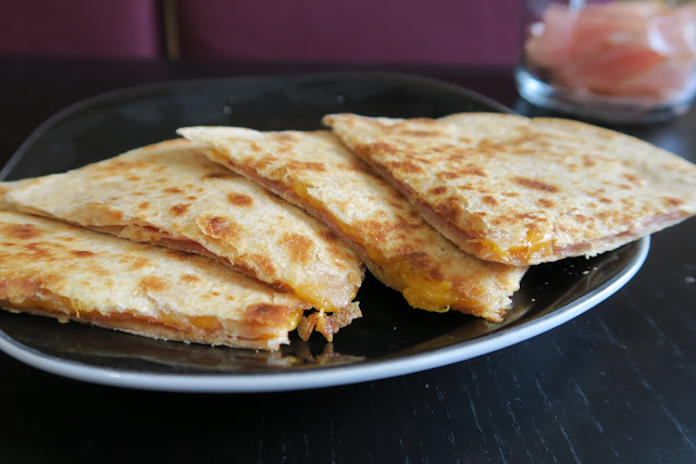 Plated ham and cheddar quesadilla