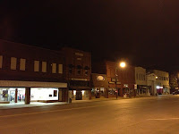 A Main Street full of businesses that are not open in the evening.