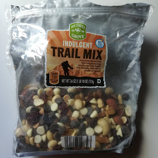 A half-empty package of Southern Grove Indulgent Trail Mix, from Aldi