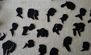 A Selection of Duplicate silhouettes on a white table cloth