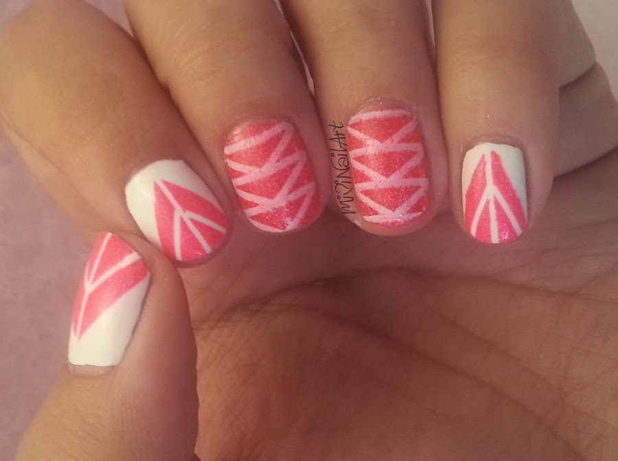 http://mivinailart.blogspot.com.es/2014/05/manicura-triangulos-estampados-y-nail.html