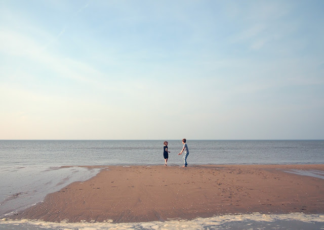 photo of 2 kids on a sand bar
