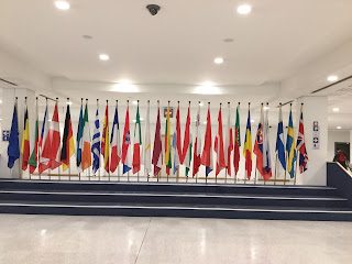 Pic of European Union flags in a line inside the reception of European Parliament, Brussels
