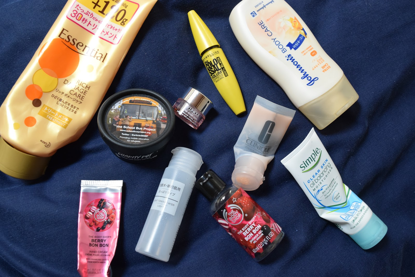 flatlay of empty beauty products including lush, muji, hair essentials and the body shop