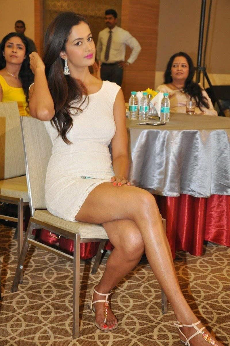 Shubra Aiyappa Photo Gallery, Shubra Aiyappa Hot Pics in White Dress Sitting on Chair