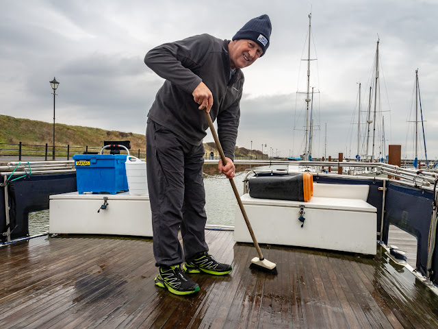 Photo of Phil cleaning Ravensdale's aft deck