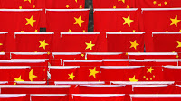 China flags (Credit: technologyreview.com) Click to Enlarge.