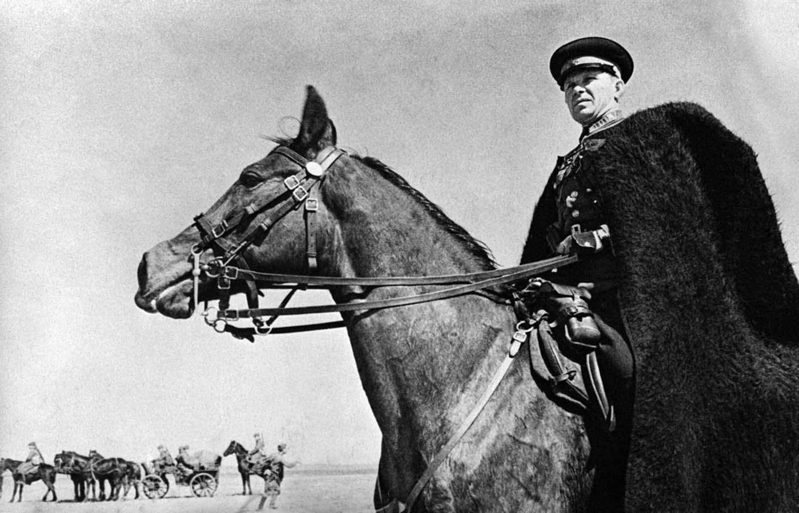 The commander of a Cossack unit on active service in the Kharkov region, Ukraine, on June 21, 1942, watching the progress of his troops.