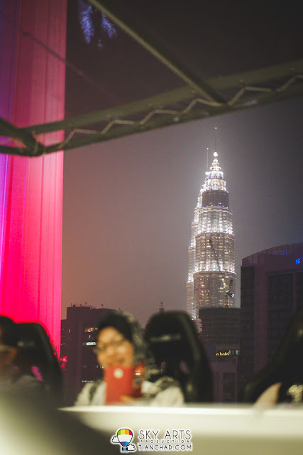 The view of Petronas Twin Towers from a distance. The pink building is KL Tower