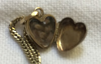 Open heart-shaped locket containing braid of hair