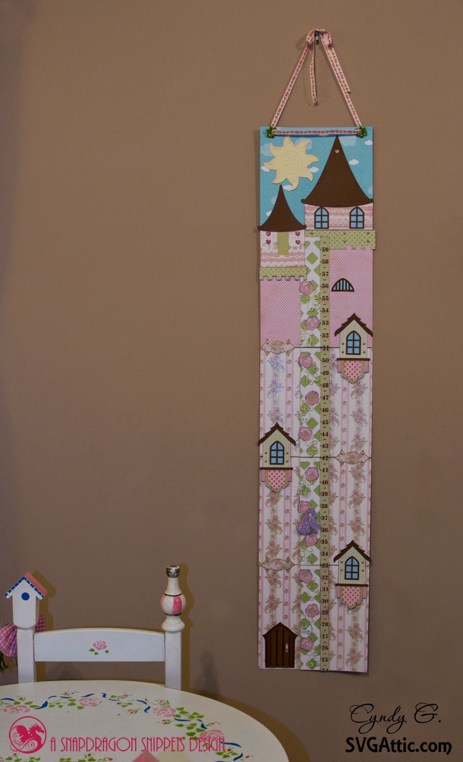 Scene - princess growth chart next to a white child's tea table