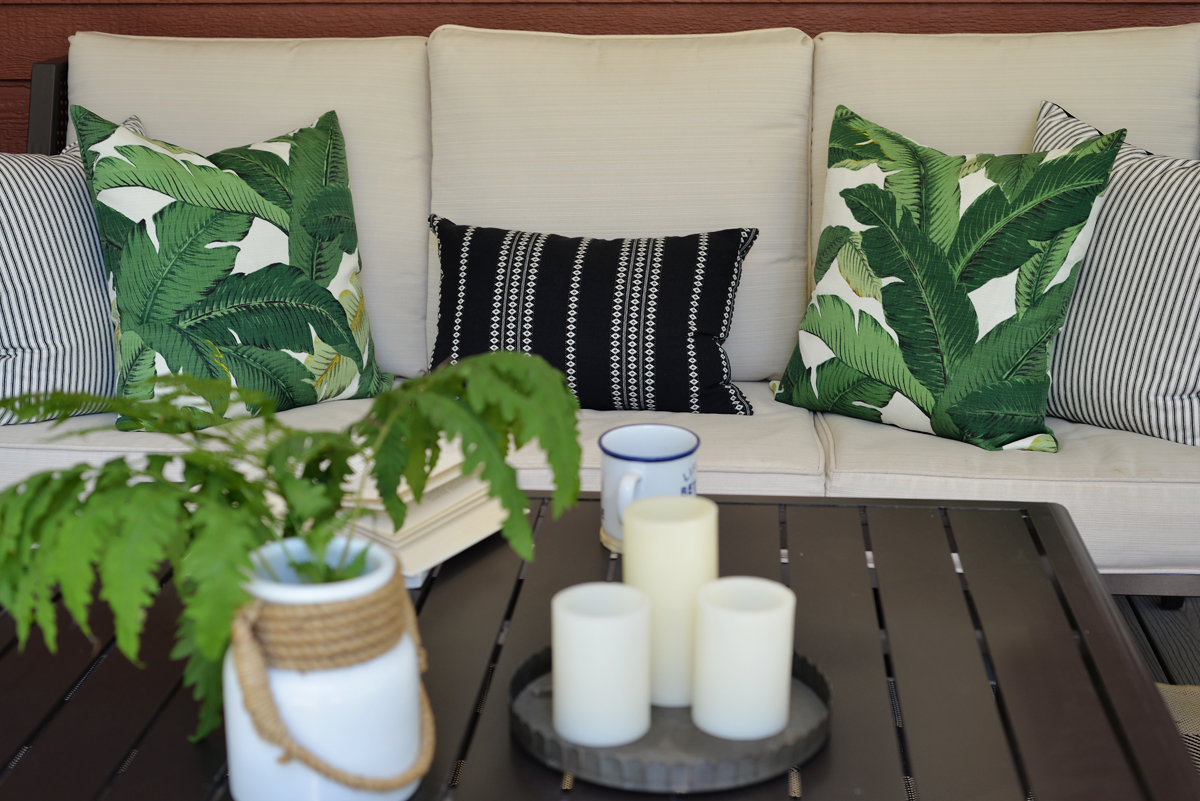 RamblingRenovators.ca | porch decor | outdoor caned chair,  plaid outdoor rug, palm leaves fabric