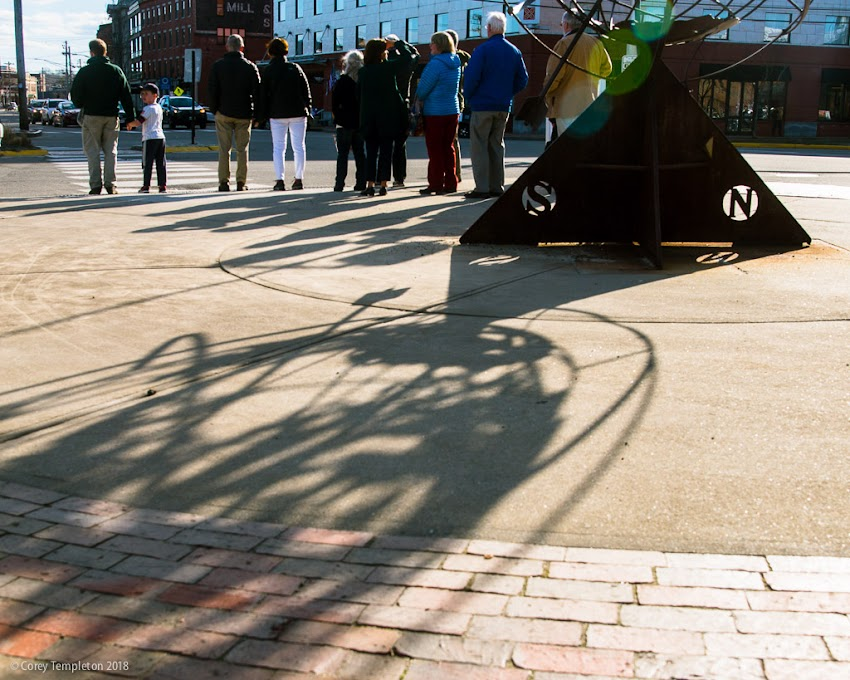 Portland, Maine USA April 2018 photo by Corey Templeton. Backs to the world (or at least the Untitled-Armillary sculpture on Commercial Street).