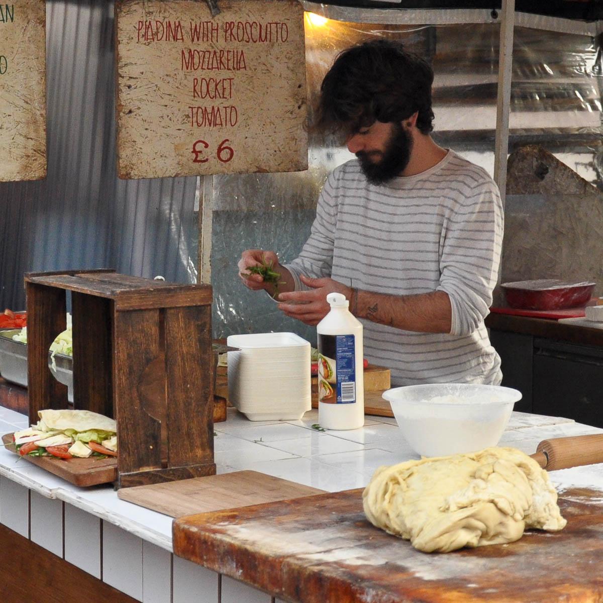 A piadina maker, Camden Lock Market, Camden Town, London, England