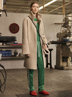 2017 Cruise Collection Rag and Bone green silk tracksuit bottom and top with long beige camel coat and red loafers with buckles