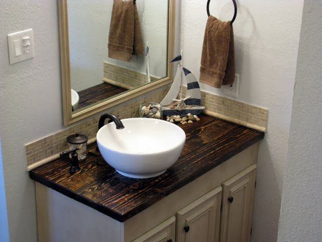 DIY rustic and budget friendly bathroom vanity. I love the rest of the bathroom makeover too!