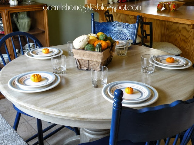 Refinished dining room table in cream with navy blue chairs - One Mile Home Style