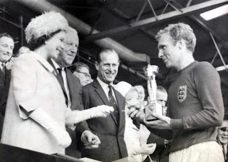 Captain Bobby Moore receives the Jules Rimet Trophy from Her Majesty the Queen at Wembley in 1966