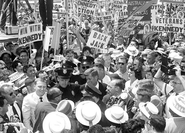 Sen. John F. Kennedy is mobbed by well wishers carrying Kennedy banners on his arrival at Los Angeles International Airport, on July 9, 1960 to personally lead his drive for the Democratic presidential nomination.