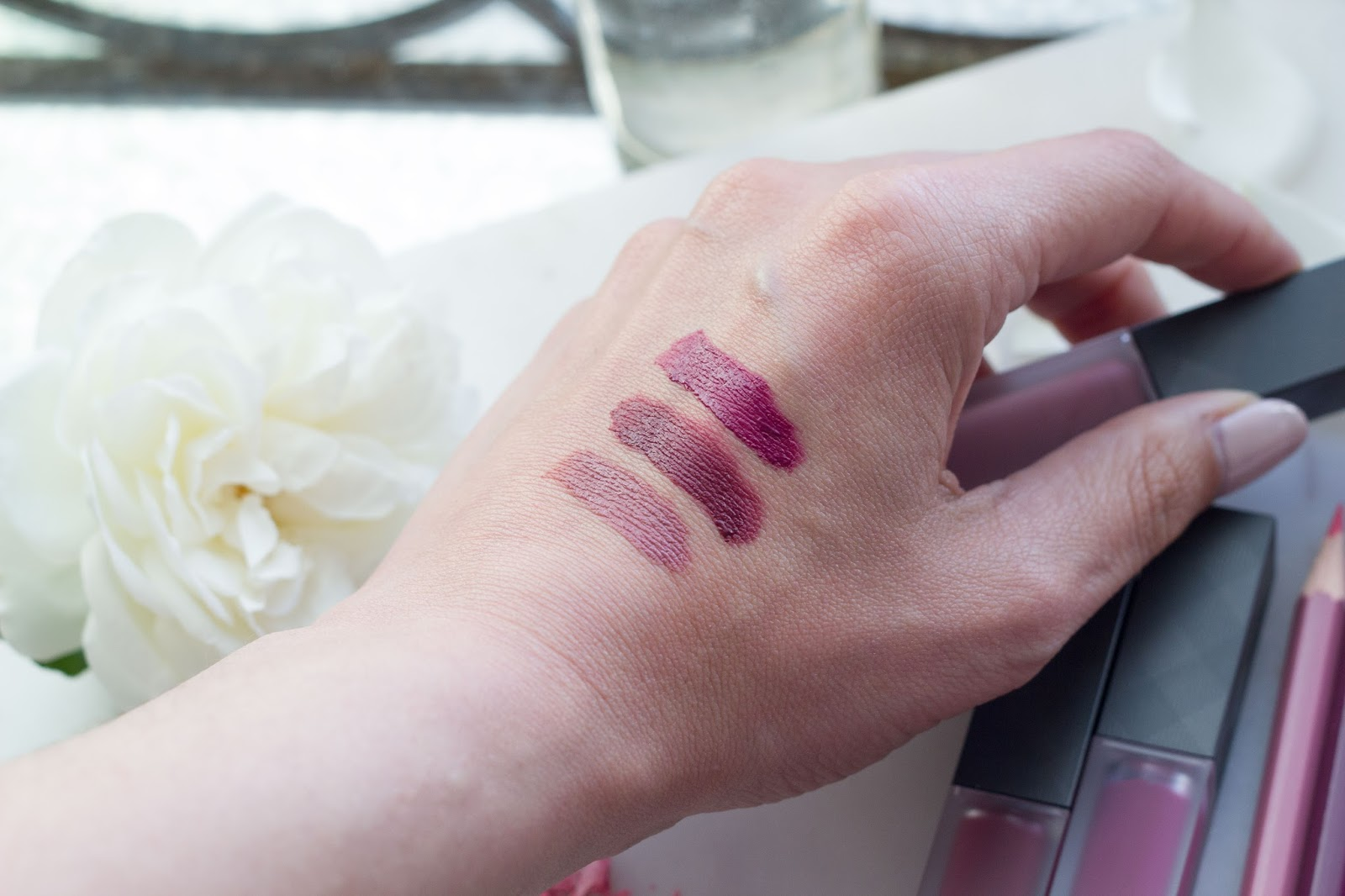 Burberry Beauty Liquid Lip Velvet color swatches, fawn, oxblood, bright plum