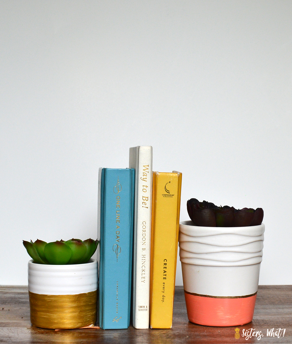 Paint some thrifted ceramic pots using painters tape with a color block pattern perfect for succulents and flowers pots