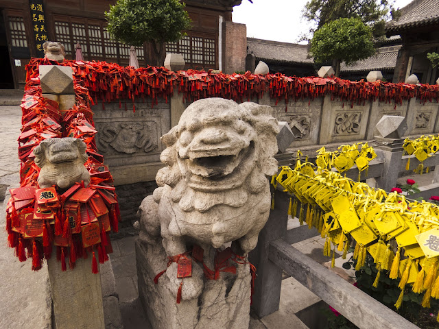 Red and yellow blessing tablets in Pingyao, China