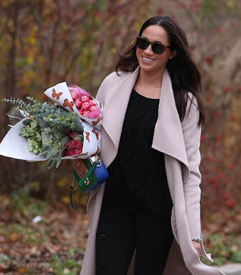 Prince Harry's Girlfriend Meghan Steps Out In Nude Coat While Clutching Bunches Of Roses