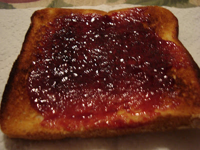 toast with red raspberry jam