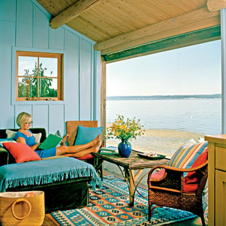 Cozy cottage loung space with door that slides up to give the amazing view