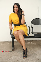 Actress Poojitha Stills in Yellow Short Dress at Darshakudu Movie Teaser Launch .COM 0219.JPG