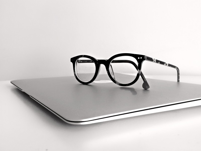 Download Black Frame Eyeglasses on Silver Macbook Air HD wallpaper. Click Visit page Button for More Images.