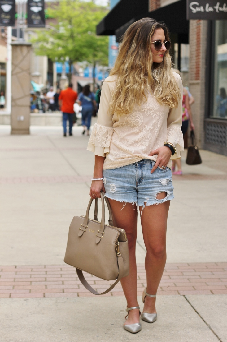 Pointed toe flats with shorts and lace shirt