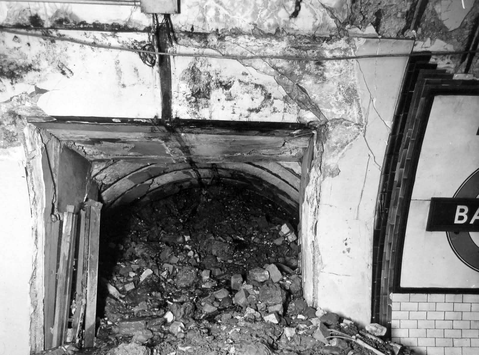 This view shows a cross-passage at the station, almost filled with rubble.