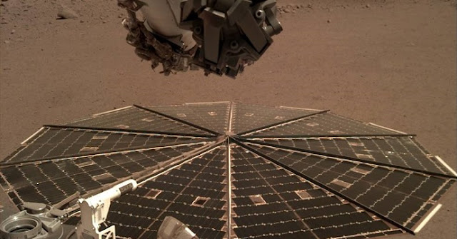One of two Mars InSight's 7-foot (2.2 meter) wide solar panels was imaged by the lander's Instrument Deployment Camera, which is fixed to the elbow of its robotic arm. Credits: NASA/JPL-Caltech