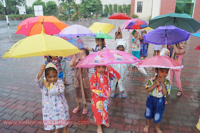 Students waving their umbrellas during Musical Rain Festivity at Green Land Convent School