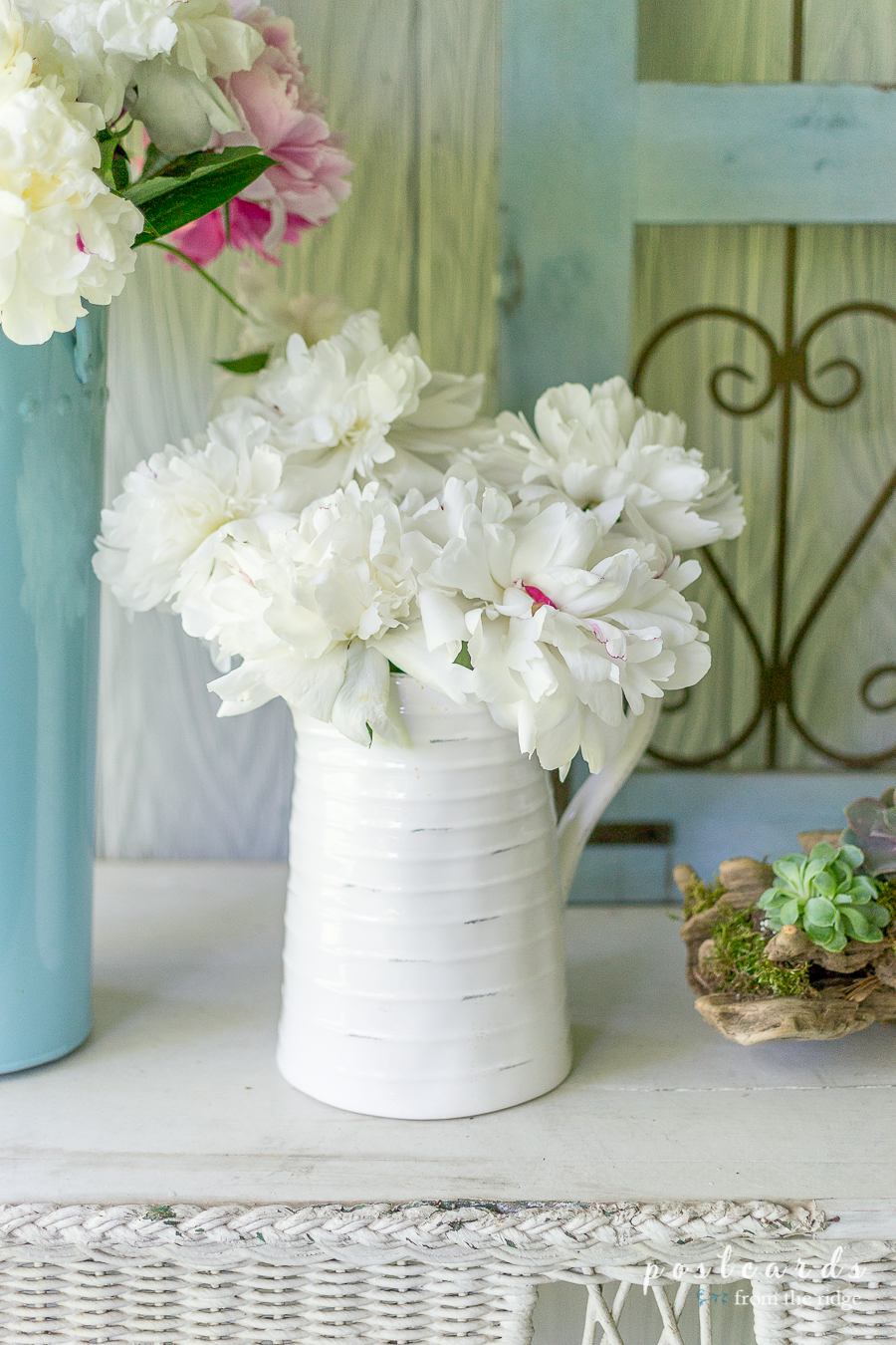 white peonies in a white pitcher