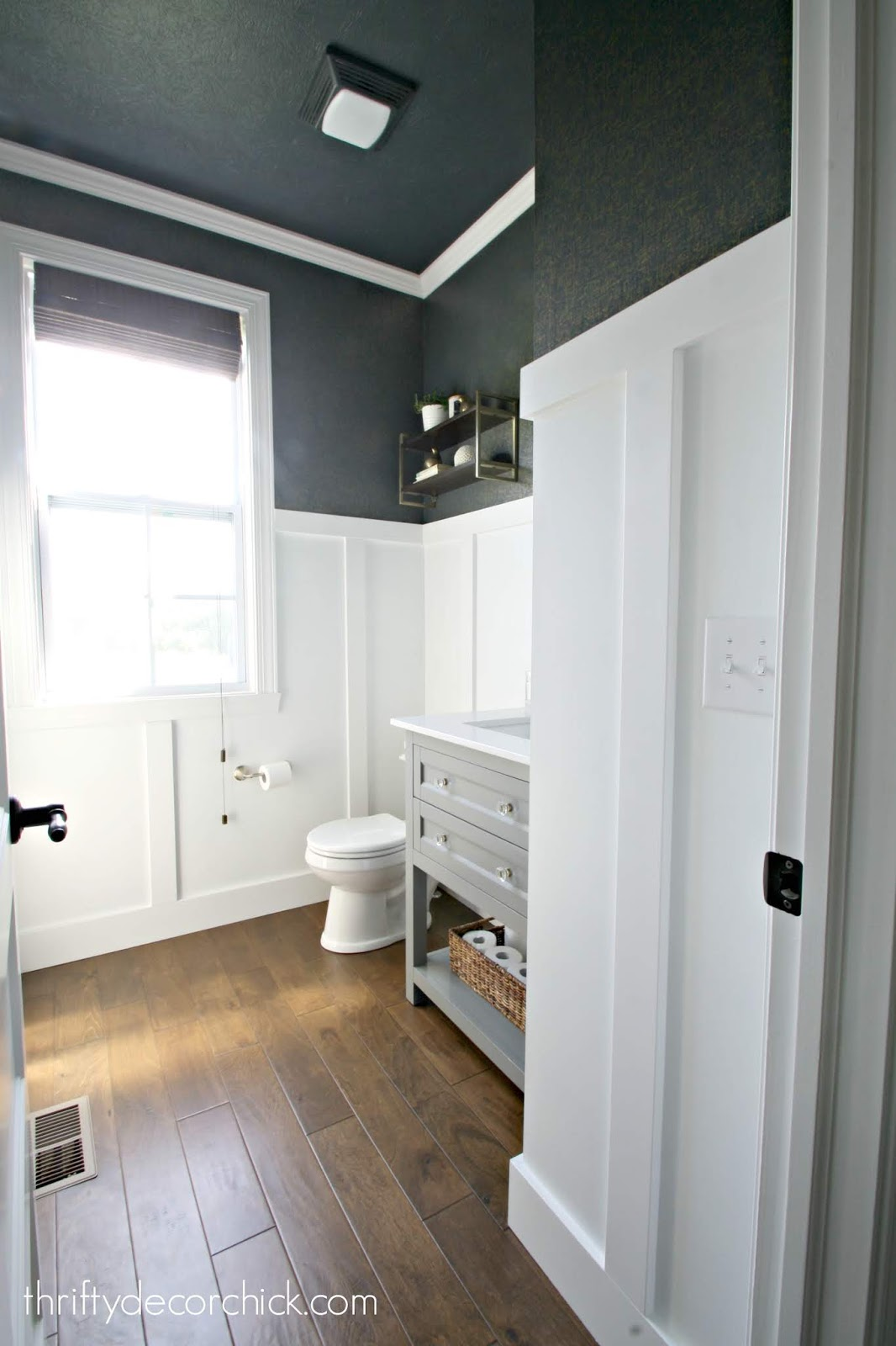 Navy walls ceiling white trim bathroom