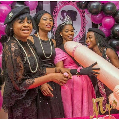 Photos: Nigerian bride presented with a giant inflatable penis shaped balloon at her bridal shower