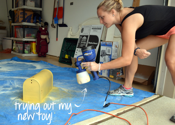 Casey using HomeRight fine finish sprayer