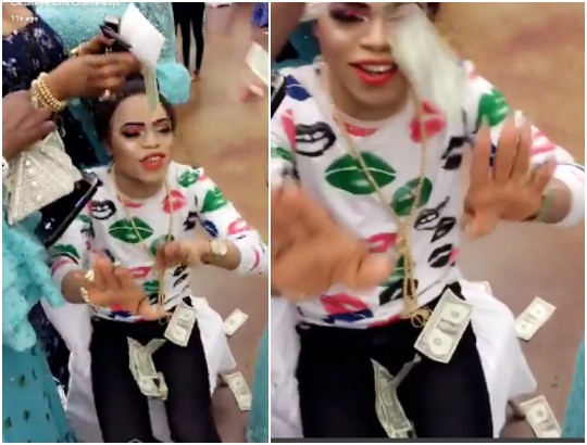 Women gather round Bobrisky to spray him dollars at a party in Chicago (Photos)