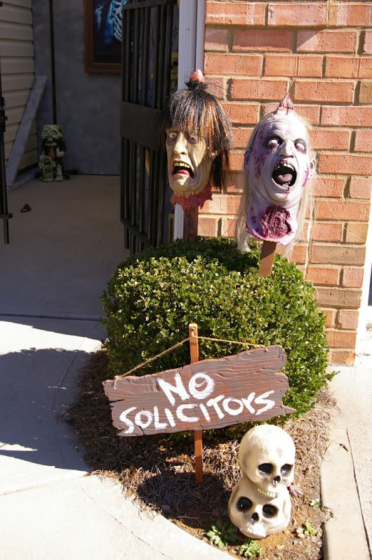 Use masks on stakes to warn off intruders for the Halloween season or as haunted house decorations