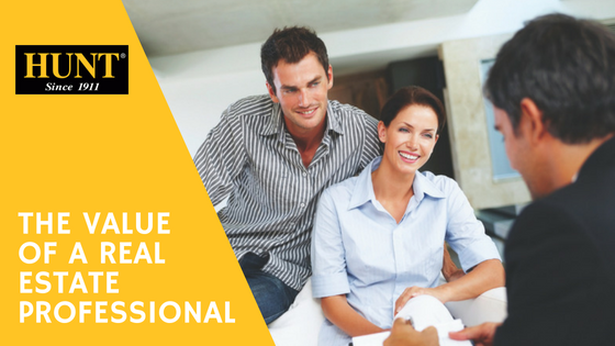 The Value of a Real Estate Professional Blog Title, male and female smiling with man holding paperwork