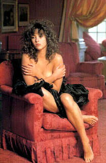 Curly Hairs Sophie Marceau On Couch And Covering Her Beautiful Assets