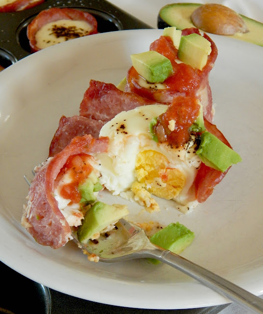 Egg and Avocado Turkey Bacon Cups...a protein-filled, hearty breakfast that's easy to prep ahread and bake off for the week ahead.  Turkey bacon, eggs, creamy avocado and salsa make the perfect bite!  Sponsored by the Iowa Egg Council. (sweetandsavoryfood.com)
