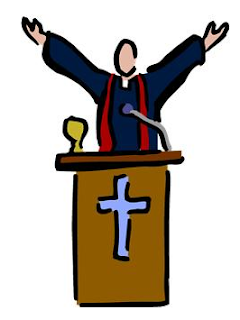 pastor behind pulpit with arms raised