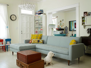 Attractive Grey Modern Sofa Bed in the Family Room with Small Bubble Lamps and Brown Tables